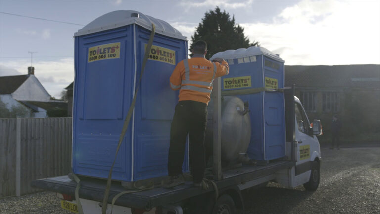 Toilets + worker unloading portaloo